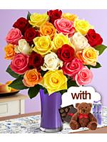 Two Dozen Vibrant Birthday Roses with Purple Vase, Chocolates, Spa Trio & Bear